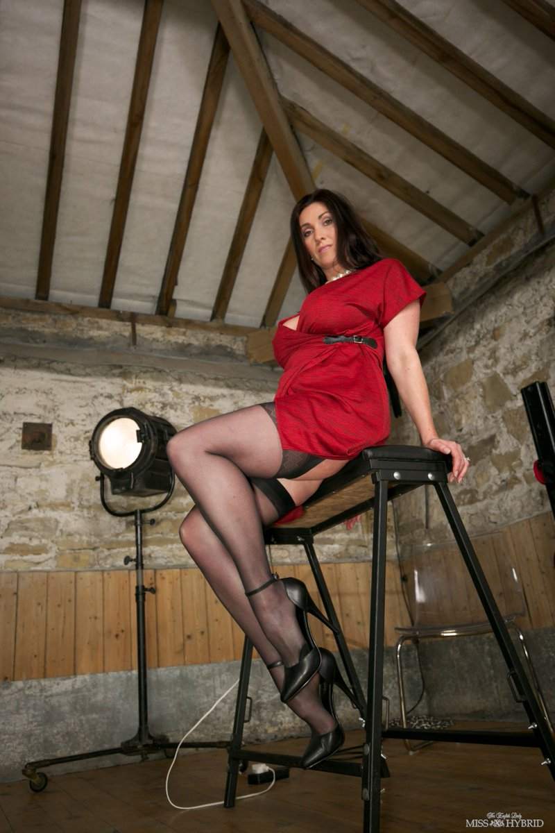 Miss Hybrid dungeon preview photos, sexy stockings long legs and sky high heels.