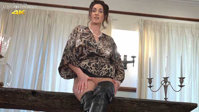 Miss Hybrid anal on the table in boots and pantyhose.