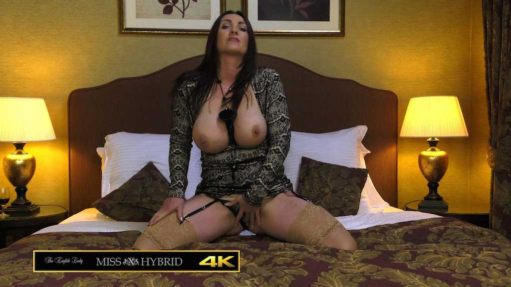 Huge tits sexy stockings and high heels Miss Hybrid plays on the bed.