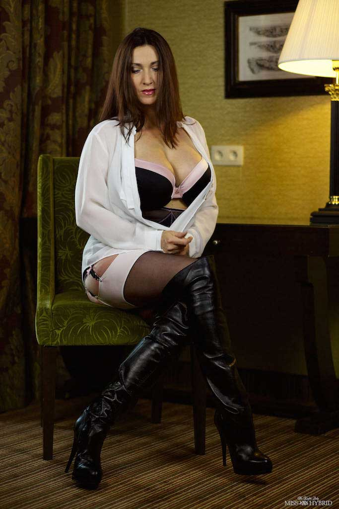 Thigh high leather boots and big tits Miss Hybrid in stockings and suspenders.