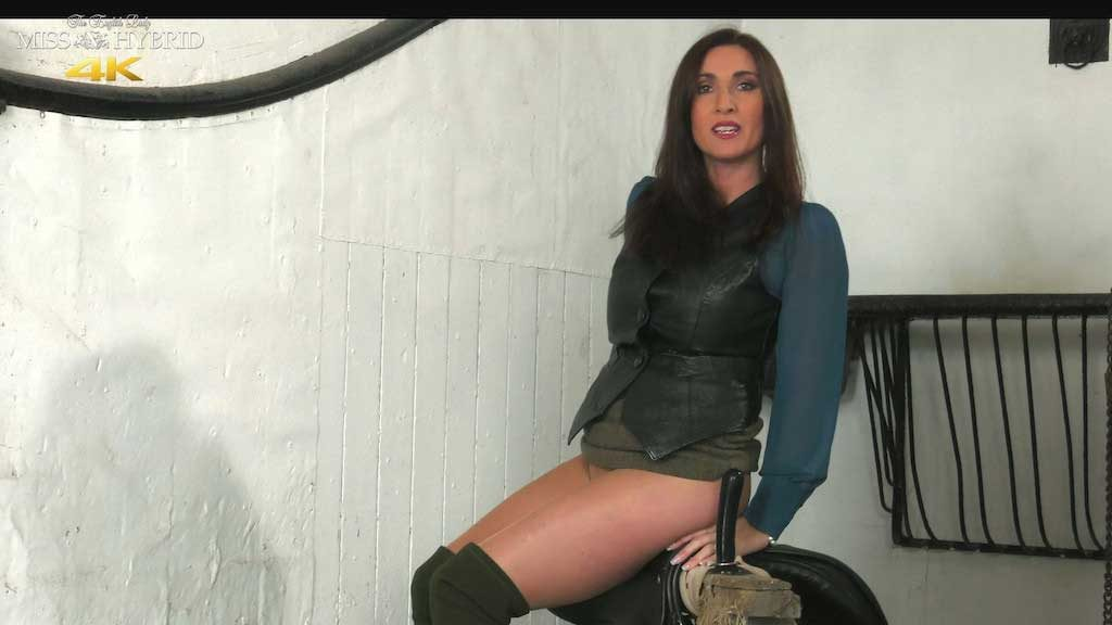 Miss Hybrid saddling up in the Manor stables in thigh high boots and pantyhose.