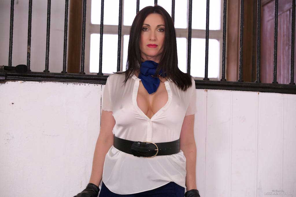 Miss Hybrid boots gloves and huge tits playing with her riding crop.