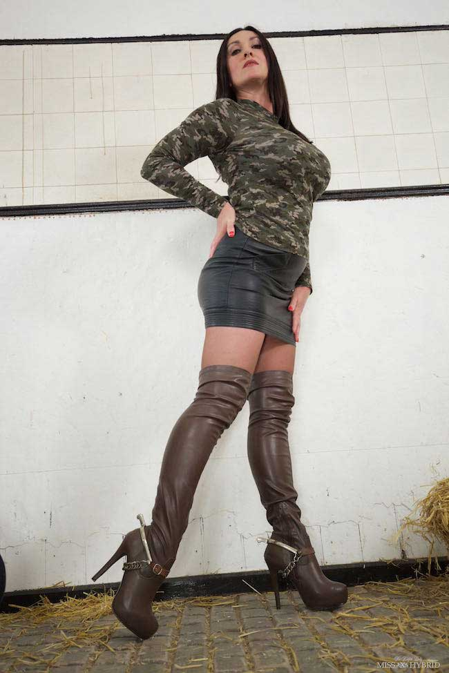 Miss Hybrid leather thigh boots spurs and leather skirt.