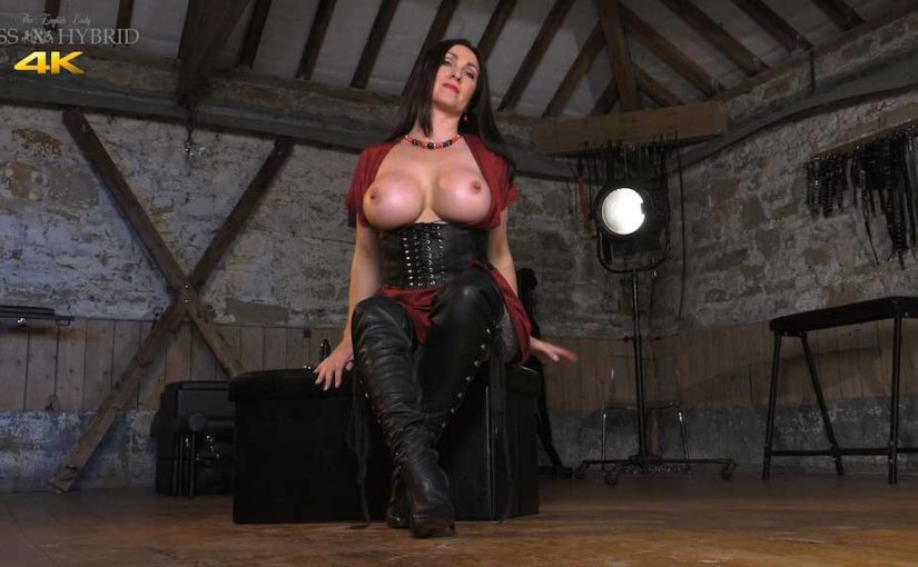 Miss Hybrid playing with sex toys has tits glazed in the dungeon.