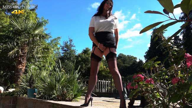 Miss Hybrid outdoor pee in stockings and heels.
