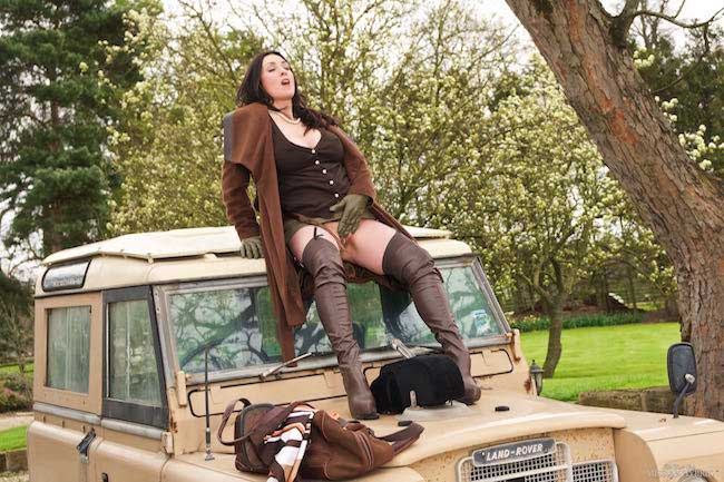 Miss Hybrid English Lady of the Manor leather thigh boots and huge cleavage.