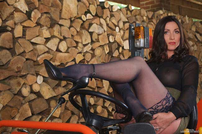 Miss Hybrid wood inspector in sexy stockings and high heels.