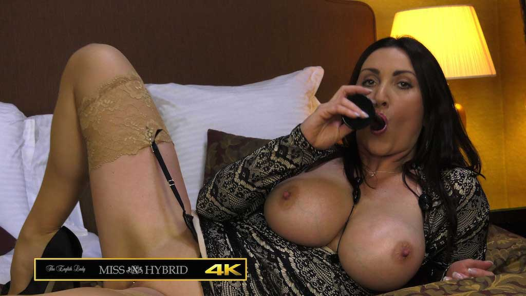 Huge tits sexy stockings and hard nipples Miss Hybrid demonstrates her deep throat technique.
