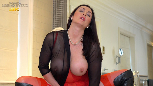 Miss Hybrid sexy red lingerie with sheer black top and huge tits.