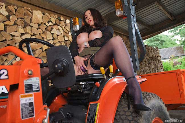 Miss Hybrid wood inspector tits out, stockings and heels riding the Manor tractor.