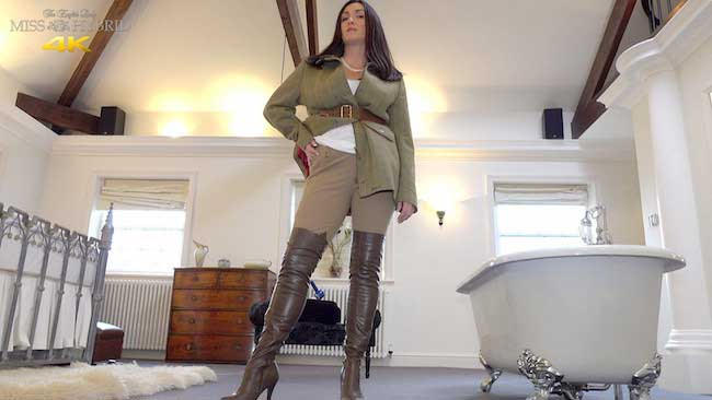 Miss Hybrid tight fitting Ralph Lauren jodhpurs and leather thigh boots riding her Hitachi Magic Wand.