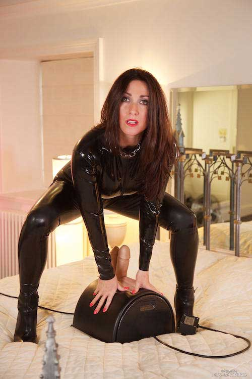 Miss Hybrid latex catsuit riding the Sybian