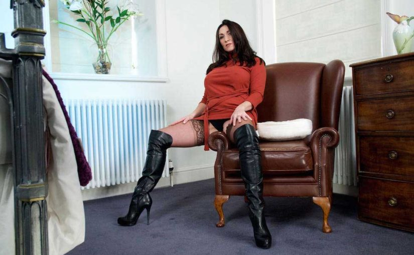 Miss Hybrid thigh high leather boots and sexy stockings.