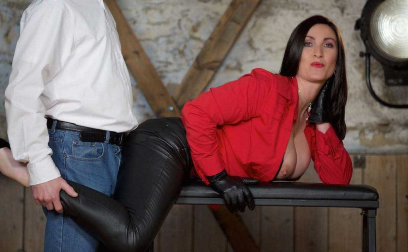 Miss Hybrid sexy red jacket, leather trousers, gloves and high heels wank instruction in the dungeon.