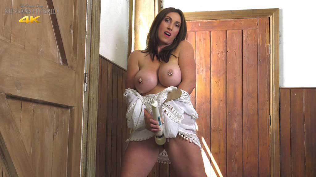 Miss Hybrid huge tits and hard nipples playing with her Magic Wand in the stables.