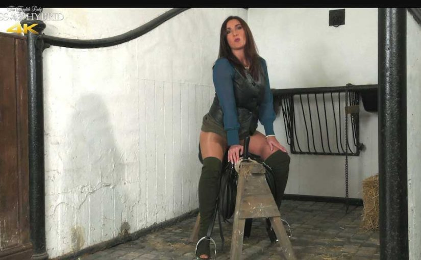 Miss Hybrid rides a big dildo in the stables, thigh boots and nylon pantyhose.