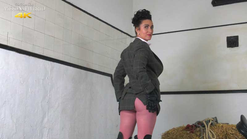 Miss Hybrid strict mistress leather boots and gloves feeling kinky.