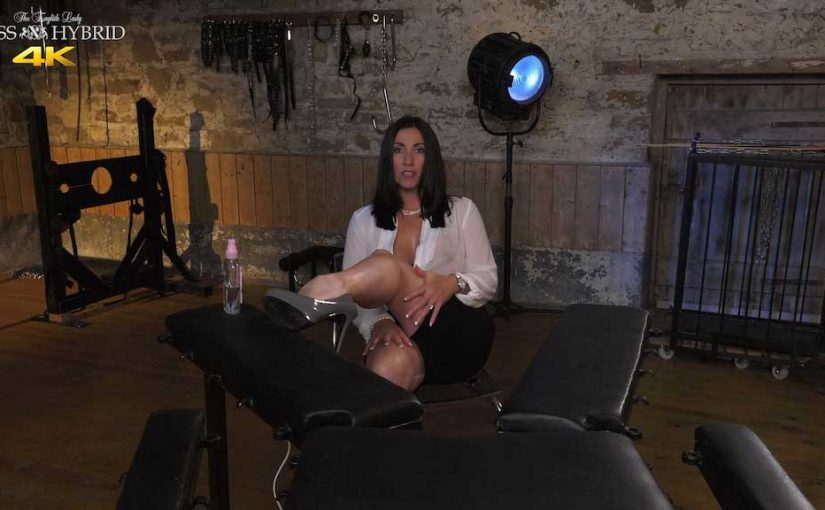 Miss Hybrid oils up her big tits and hard nipples in the Manor dungeon.