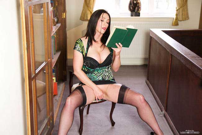 Miss Hybrid erotica reading in sexy stockings and stiletto heels.