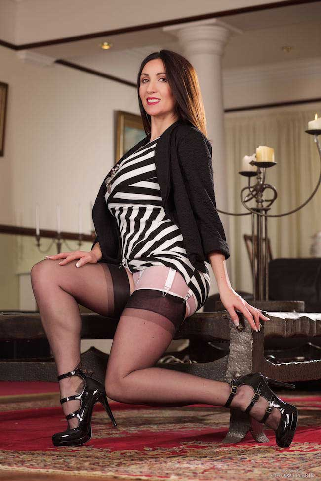 Miss Hybrid ripped stockings with sheer panties and stiletto heels.