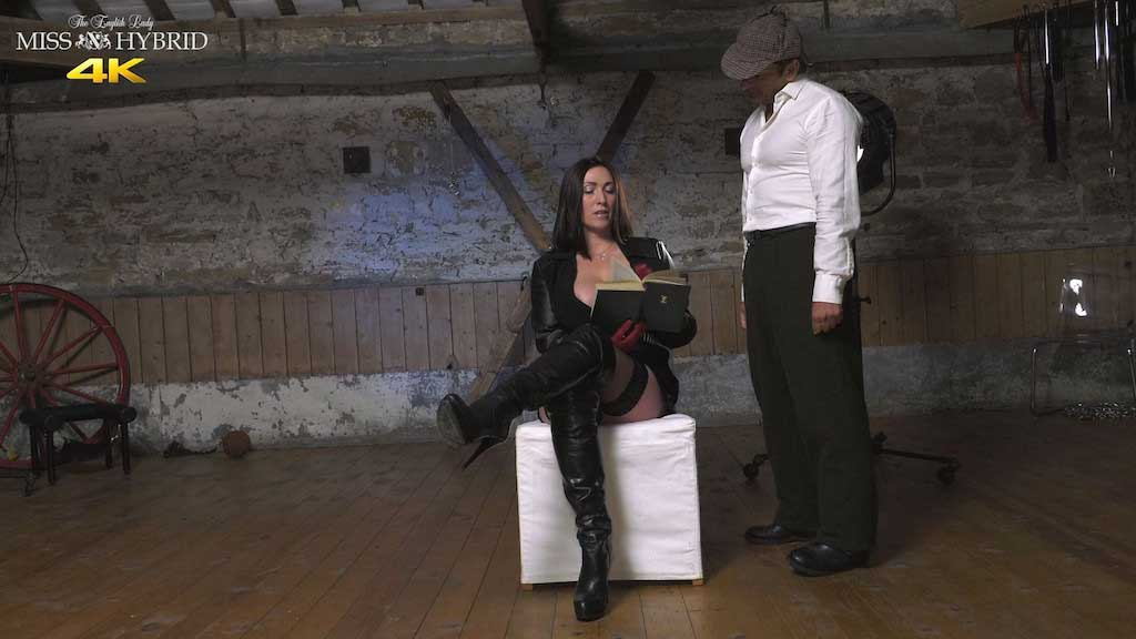 Miss Hybrid unwanted interruption huge tits leather boots and stockings.