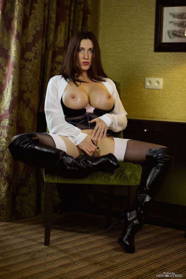 Thigh high leather boots and big tits out in the hotel room.