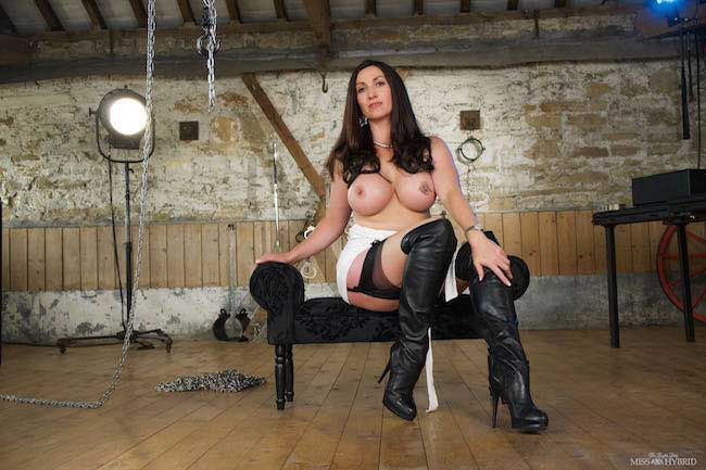 Miss Hybrid leather fetish and stockings riding the Sybian.