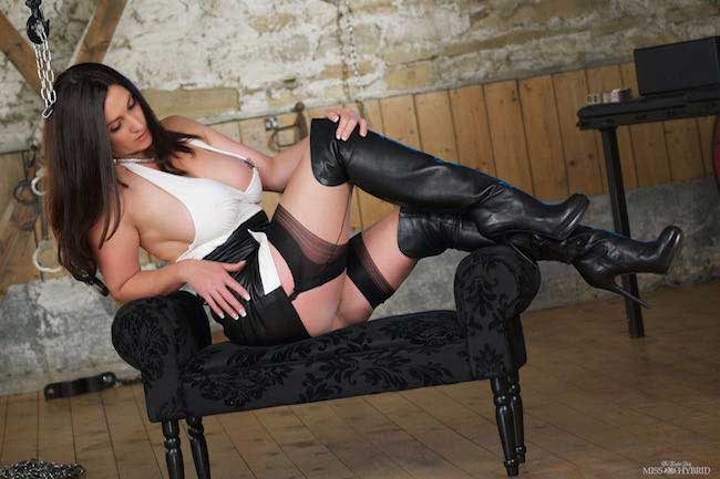 Miss Hybrid leather fetish thigh boots and huge tits.