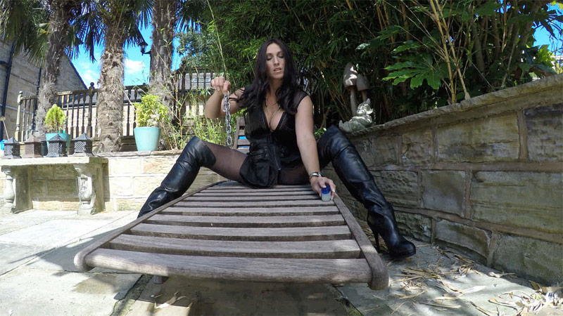 Miss Hybrid free September newsletter chaining outdoors in thigh boots.